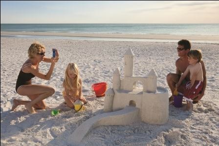 Family Builds Sandcastle © Naples CVB