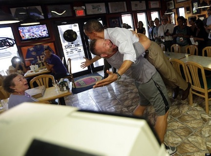 Obama lifted by Scott Van Duzer (credit: Pablo Martinez Monsivais/AP)