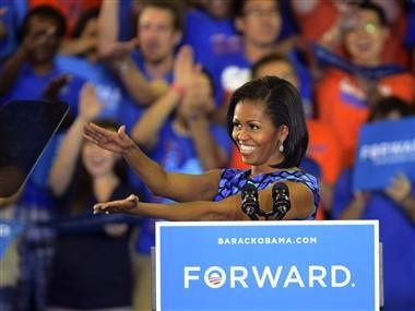 Mrs Obama does the Gator Chomp (credit: Associated Press)